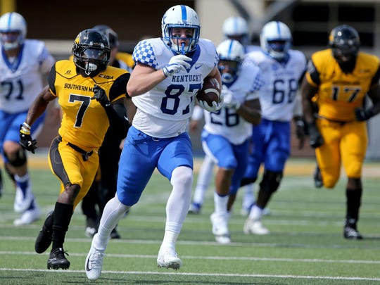 Sep 2, 2017; Hattiesburg, MS, USA; Kentucky Wildcats tight end C.J. Conrad (87) runs from Southern Miss Golden Eagles defensive back Jomez Applewhite (7) after a catch in the first quarter at M. M. Roberts Stadium.