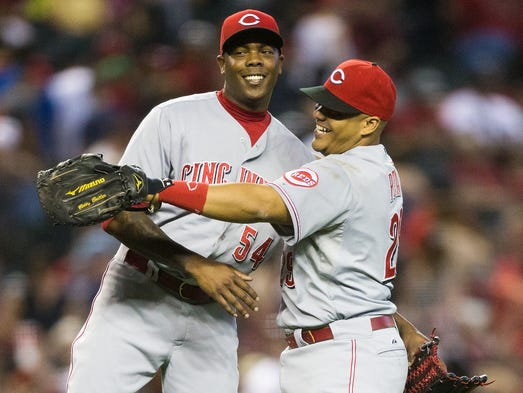 Reds closer Aroldis Chapman (left) and Bryan Pena clebrate their 4-3 win against the Diamondbacks at Chase Field in Phoenix, Ariz. June 1, 2014.
