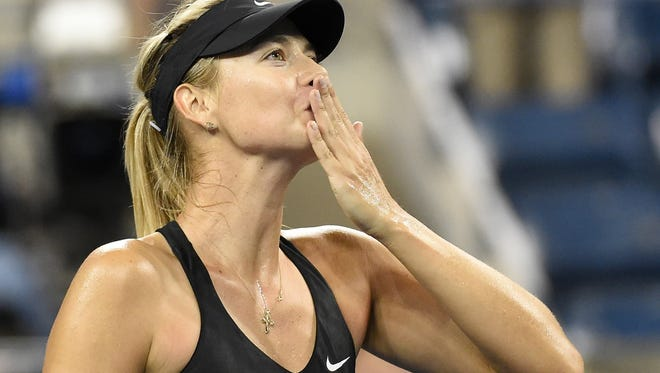 Maria Sharapova reacts after beating Sabine Lisicki on day five of the 2014 U.S. Open tennis tournament at USTA Billie Jean King National Tennis Center.