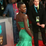Actor Lupita Nyong'o poses for photographers on the red carpet at the EE British Academy Film Awards on Feb. 16 at the Royal Opera House in London.