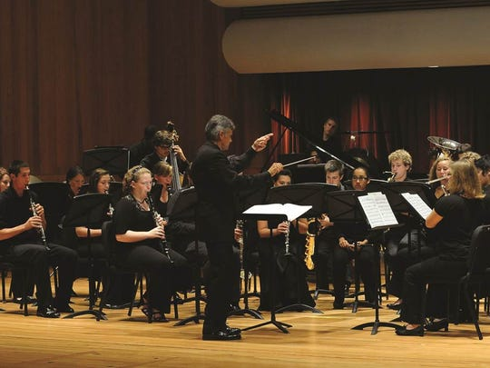 Frederick Speck leads the University of Louisville Wind Ensemble.