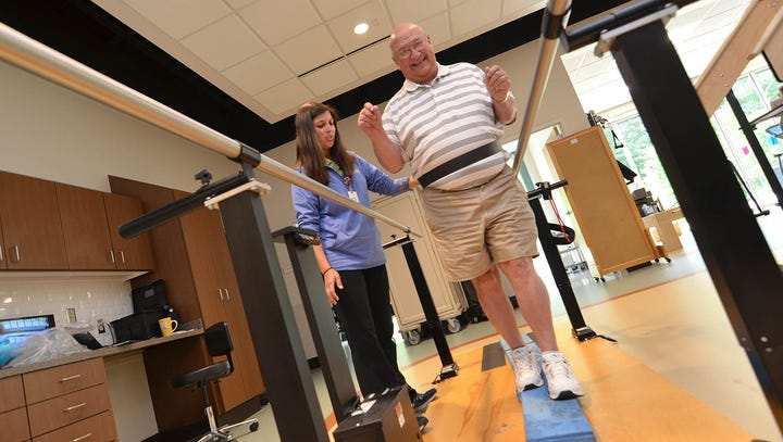 State Rep. Gary Chism tests his balance skills during