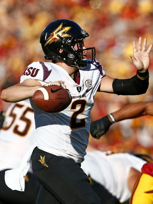 Arizona State's Mike Bercovici drops back to throw a pass against USC on Saturday, Oct. 4, 2014, at Memorial Coliseum in Los Angeles.