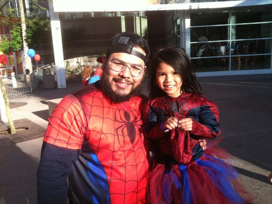 Sergio Rojo and 4-year-old daughter Sierra, in her