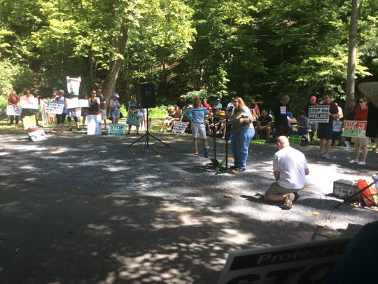 Karen Feridun of Berk's Gas Truth, a Pennysylvanian grassroots citizens action group, speaks at the anti-PennEast Rally in Milford on Saturday.