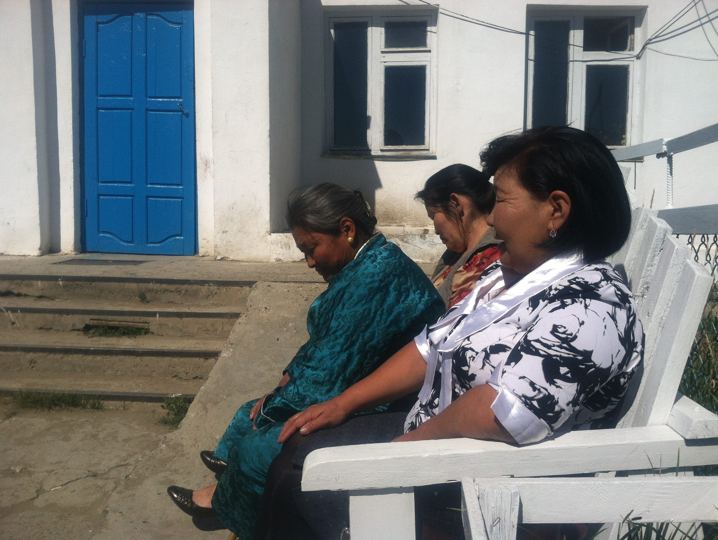 Three women take a break during a day-long session