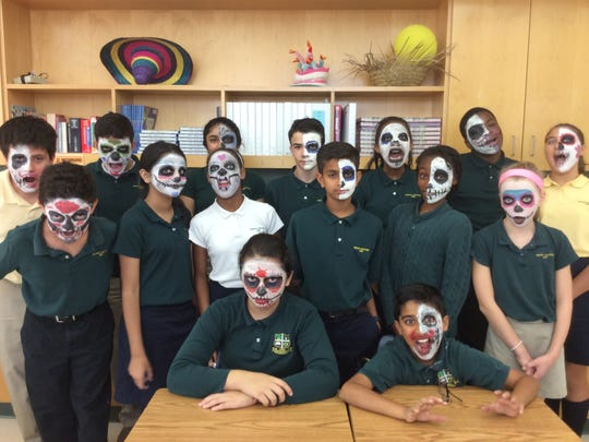 The Wardlaw-Hartridge School seventh graders show off their painted faces to honor El Dia de los Muertos