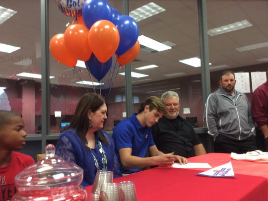 Pineville pitcher Hunter Eyre signs with Louisiana College Friday.