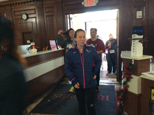 Runners arrive back at the Rutgers College Avenue Gym after running the Big Chill 5K Race.