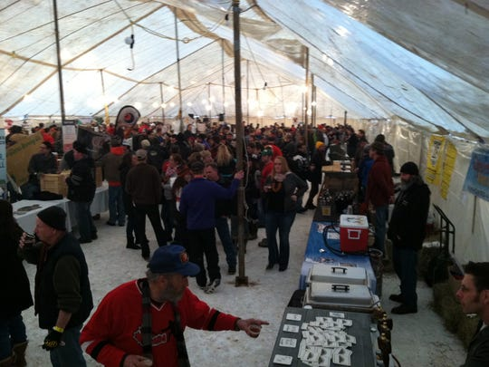 The 18th annual Ice Cold Beer Fest in downtown Minocqua is held in a large heated tent in downtown Minocqua.