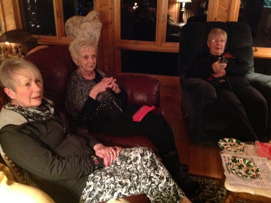 Judy Brown (center) with friends Mary Ann Tolf (left) and Marian Herriman (right) in December 2014. Brown was one of six people killed in a series of shootings this weekend in Kalamazoo.