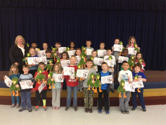 Whitehouse School's 1,000-Minute Readers Bottom row (from left): Gracelyn Spicer, Shawn Spring, Jake Kopacz, Harper Bracken,  Nathan Spicer, Cameron Hess, Zachary Barckholtz, Diego Gonzales, and Ben Brinkofski. Center row: Annie Johnson, Joey Cirianni, Olivia Davis, Autumn Connolly, Jordyn Moran, Jacob Ross, Sean Souvenir, and Angelina Tenore. Back row: Mrs. Zanardi, Taheem Ahmed, Ava Infante, Vincenzo Albano, Riya Gupta,  Joe Kaecker, Elizabeth Krzyzanowski, Mackenzie Schneider, and Grace Cowart.