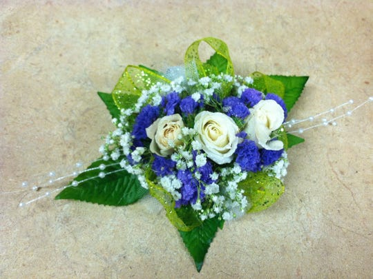 Before she joined The Enquirer, Anne Saker worked in the floral department of Kroger in Mason. She took a lot of photos of flowers, including this corsage she made.