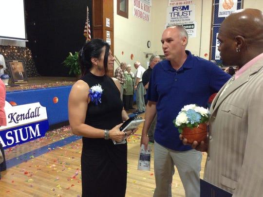 Former McConnellsburg player Nikki Seiders, left, talks