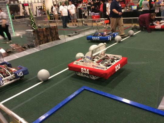 These robots are setting up to play a match. The robot at the far right, No. 4281, is from the Center School in Branchburg