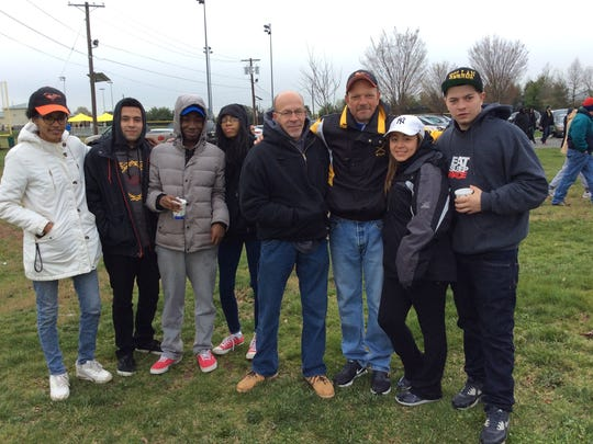 Cassandra Begin, Danny Sepulveda, Jerome Ried, Zaniyah Ford, Dave Hollan, Rob Hollan, Yvonne Idania and Connor Hollan wait for the Piscataway Little League Opening Day Parade.