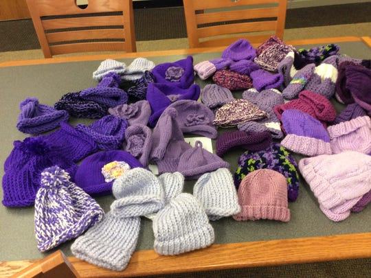 Look at all the purple baby hats we got at the Hunterdon