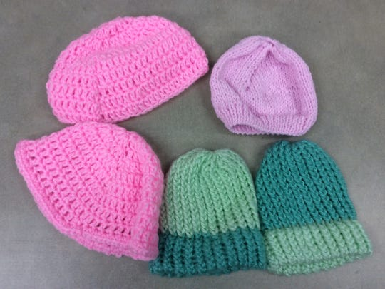 These hat aren't purple, but they will be used at Children's Specialized Hospital or Beth Israel Medical Center.