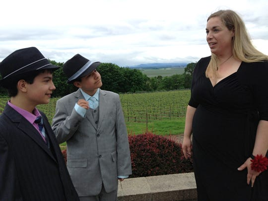 Oregon Connections Academy 10th grade students Arjay and Jaymes Hamilton-Perez, twin brothers from Salem, chat with ORCA Executive Director Allison Galvin prior to the school's first prom, held Saturday, April 23 at the Chemeketa Eola Viticulture Center.