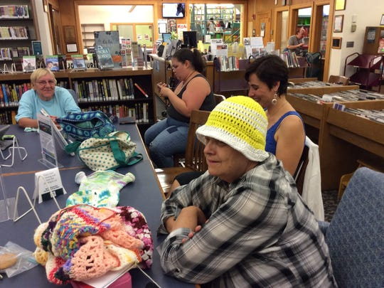 There is open knitting every seond and fourth Monday evening at the Bound Brook Library. Karen Van Ravenswaay, modeling her yellow-and-white sun hat, is the founder of the group. All are welcome.