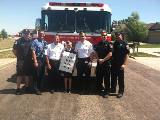 Jaykob Knutson, 12, of Sioux Falls finished his final IV chemo treatment Tuesday, July 26, 2016. Sioux Falls Fire Rescue escorted him to his final treatment.