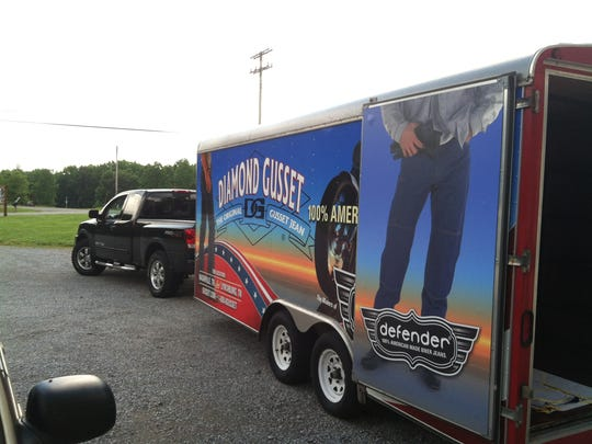 The Diamond Gusset Jeans mobile store features someone wearing the company's Defender jeans designed for motorcycle enthusiasts.