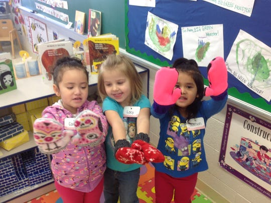 Ms. Tiffinie's AM Head Start Class at Early Learning Center in North Fond du Lac also received mittens. Pictured, from left: Camilla, Lacy and Allison