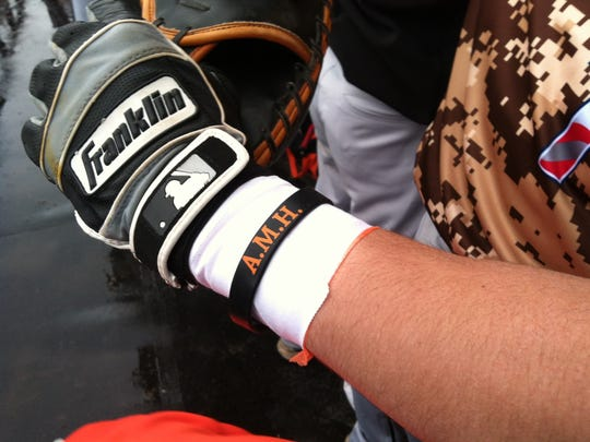 Players and coaches at the Tribute to Our Troops wore black wristbands honoring Central Kitsap teacher Amy Higgins, who died in March after being struck by a car while jogging. Higgins' son Bryce Higgins is a senior and plays first base for Central Kitsap.