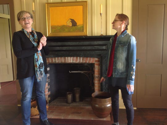 Peggy Moretti (left) and Karla Pearlstein talk about the Delaney House in the dining area.