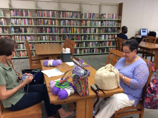 Some of the women who came to our Knitting in Public Day Stitch-A-Thon at the Franklin Park Library sat inside, where it was a lot cooler.