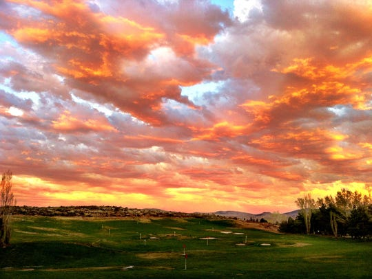 The sun sets over the driving range at Lakeridge Golf