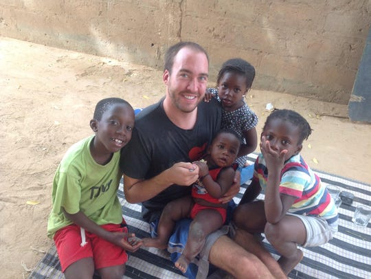Nate Zimdars is pictured with Senegalese children.
