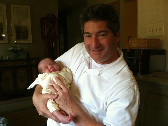 636440947630491732-Matt-Zanger-and-infant.JPG