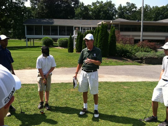 In this 2013 file photo, Spackenkill High School boys golf coach Keith Humphrey chats with his team prior to the start of practice at McCann Memorial Golf Course in Poughkeepsie.
