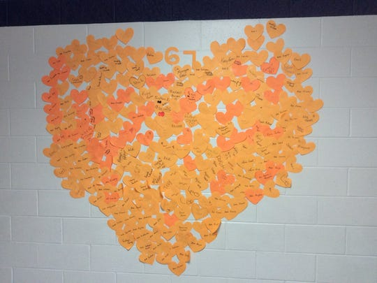 D.C. Everest Middle School students used paper hearts to show love for hurricane victims.