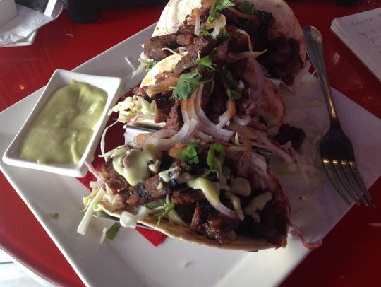 The Galbi Tacos are Korean-style barbecue short ribs