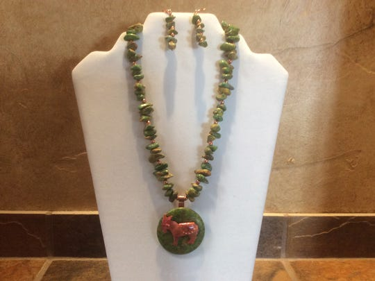 A piece of jewelry made by one of the artists participating in this year's Holly Day House.