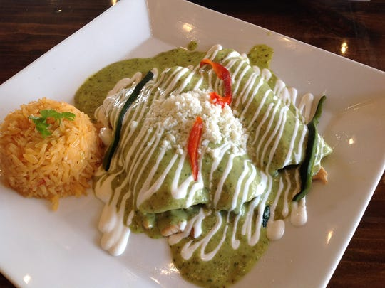 The chicken and spinach enchiladas ($11.49) at La Paloma Mexican Grill is one of the my favorite dishes. This restaurant has excellent sauces, food, and presentation. You will find many unique menu items.