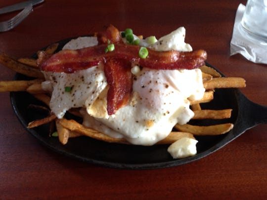 The Breakfast Poutine ($8) features hand cut fries, topped with sage and rosemary sausage gravy, fried egg, bacon, cheese curds and green onion. It's delicious but incredibly heavy.