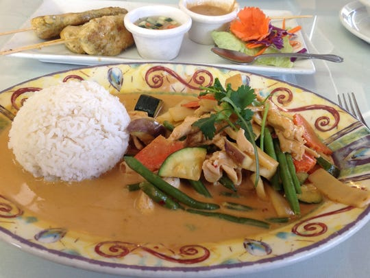 The Red Curry ($7.99) is my favorite dish. Tender chunks of chicken swim in a bath of red curry sauce with assorted vegetables. It is topped with Thai basil.