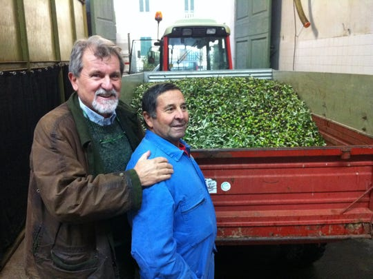Enzo Corti, left, and a worker at the Calosi frantoio in Tavarnelle, Tuscany.