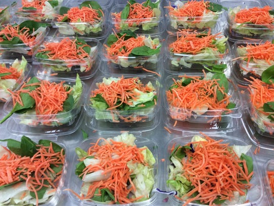 Prepared salads are served with some meals at D.C.