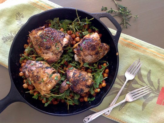 Pan-Roasted Chicken with Smoked Paprika nestles on a bed of chickpeas,.