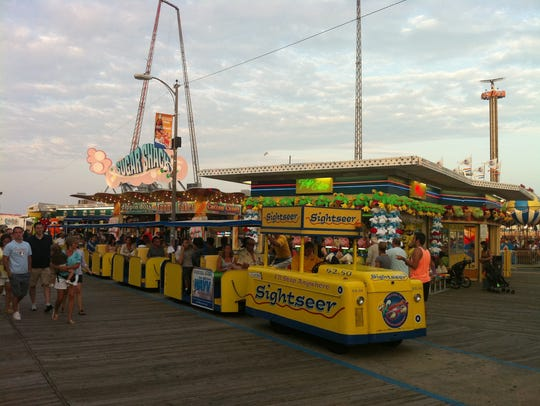 A tram car moves along the boardwalk in Wildwood in
