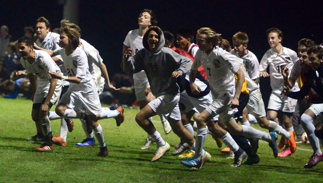 The Station Camp High soccer players run off the bench to celebrate Saturday evening's 4-3 victory over Franklin, which earned the Bison program its first state-tournament berth since 2009.