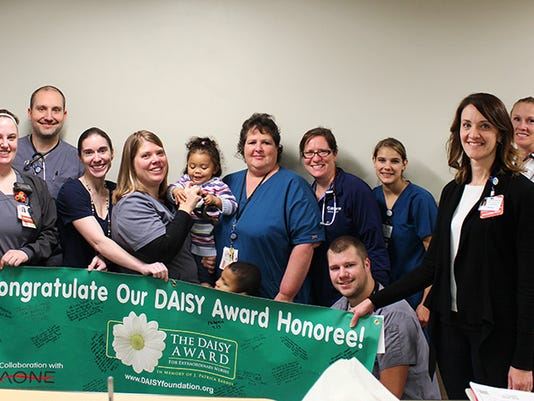636149867029599991-Andrea-Rich-honored-with-DAISY-Award-Group.jpg