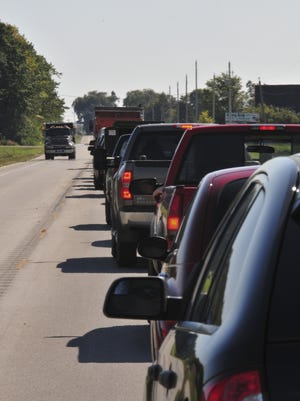 Traffic on Wisconsin 42 between Sturgeon Bay and Egg Harbor is stopped while crews rebuild one lane at a time in September 2014. Egg Harbor residents recently discussed upcoming WI 42 improvements in town.