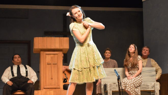 """15-year-old Denise (played by Mary Rose Schwier) performs in """"Smoke on the Mountain."""""""