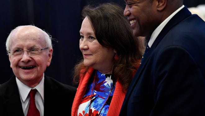 Former state representative Bob Hunter (left) and Abilene Mayor Anthony Williams talk Tuesday with Cecilia Abbott, wife of Gov. Greg Abbott. The first lady of Texas was the keynote speaker for the FlourishNow luncheon at the Abilene Convention Center.