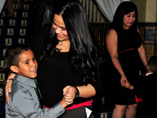Joshua Lopez dances with his mom, Angel Reyes, during